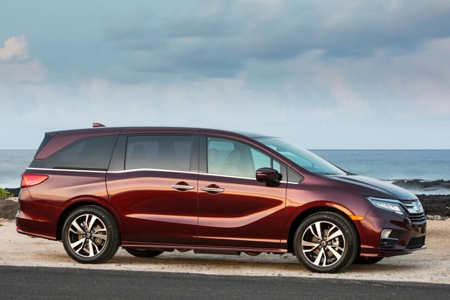 Red-2020-Honda-Odyssey-in-front-of-water-from-exterior-passenger-side_o