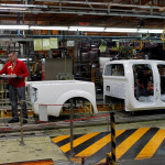Nissan Motor staff work in a manufacturing chain at the Zona Franca Nissan factory near Barcelona