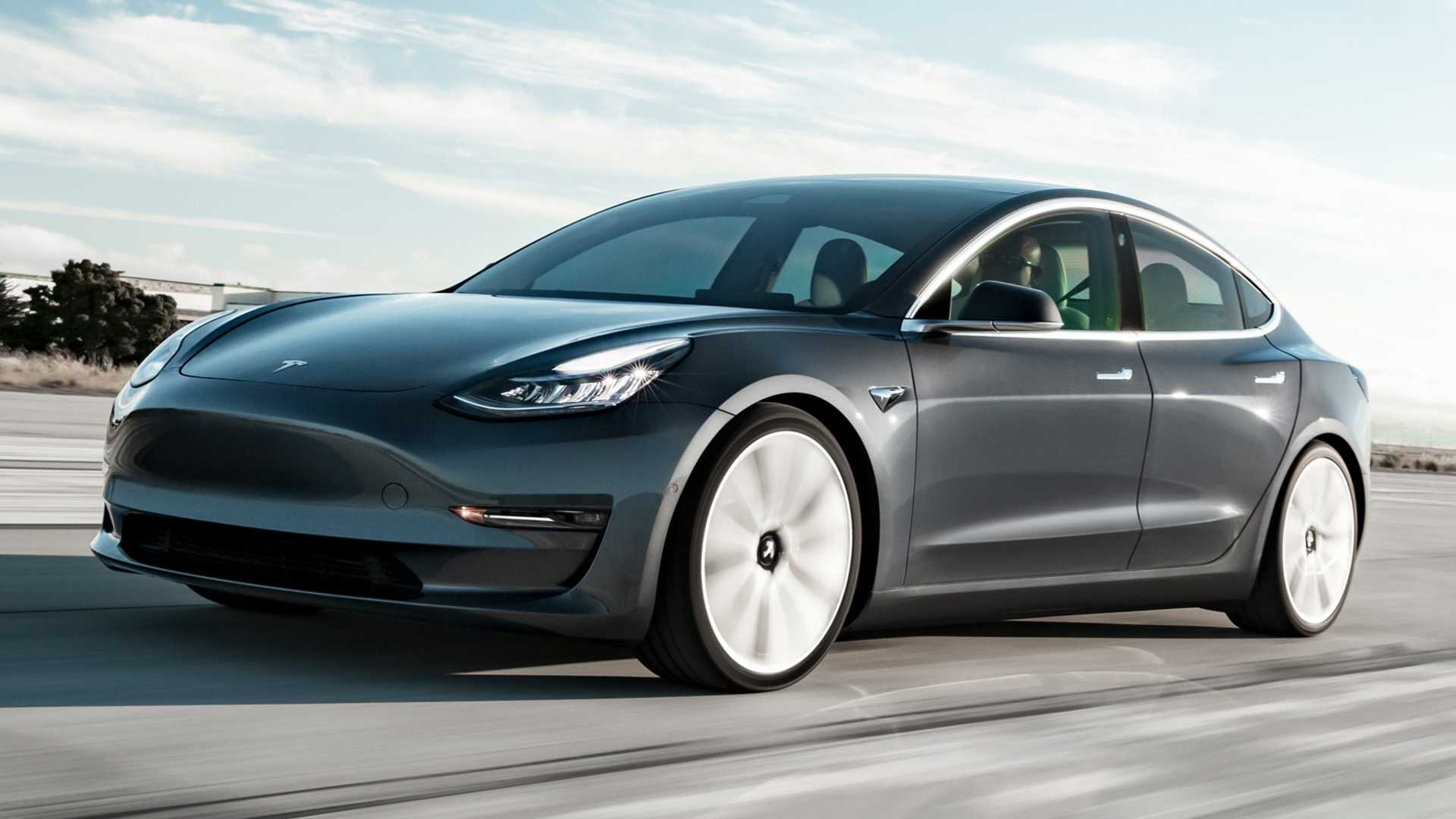 tesla-model-3-driving-on-road-with-sun-set